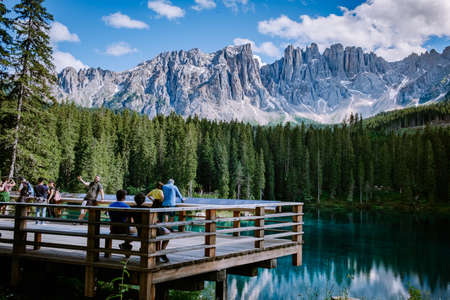 Dolomites Italy, Carezza lake Lago di Carezza July 2020, Karersee with Mount Latemar, province, South tyrol, Italy. Landscape of Lake Carezza or Karersee and Dolomites in background, Nova Levante, Italy. Europe Reklamní fotografie