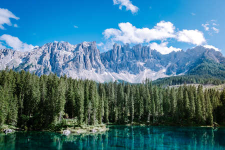 bleu lake in the dolomites Italy, Carezza lake Lago di Carezza, Karersee with Mount Latemar, province, South tyrol, Italy. Landscape of Lake Carezza or Karersee and Dolomites in background, Nova Levante, , Italy. Europe Reklamní fotografie