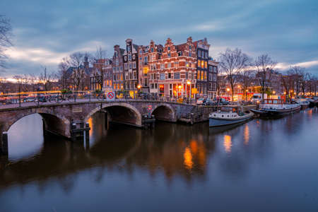 Amsterdam canals Netherlands, Amsterdam Holland during sunset evening during wintertime in the Netherlands. Europe