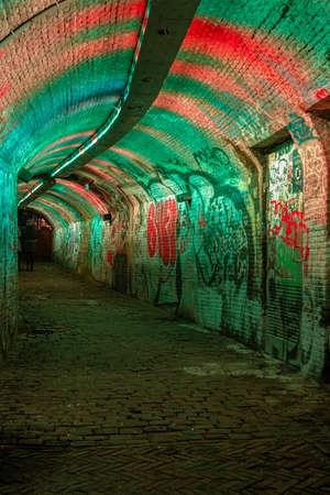 Utrecht Netherlands January 2021, colorful green, blue, pink illuminated Ganzemarkt tunnel in the center of Utrecht, The Netherlands