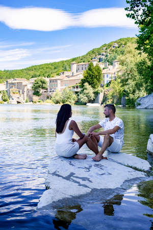 Balazuc in Southern France, Ardeche district France. couple mid age men and woman on a road trip in France visiting the village of Balazuc