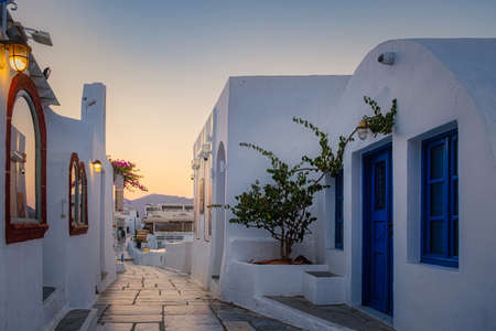 Oia village Santorini with blue domes and white washed house during sunset at the Island of Santorini Greece Europe, sunrise Santorini