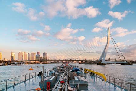 Binnenvaart, Translation Inlandshipping on the river Nieuwe Maas Rotterdam Netherlands during sunset hours, Gas tanker vessel Rotterdam oil and gas transport. Netherlands Stock fotó