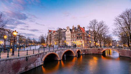 Amsterdam Netherlands during sunset, historical canals during sunset hours. Dutch historical canals in Amsterdam Stock Photo