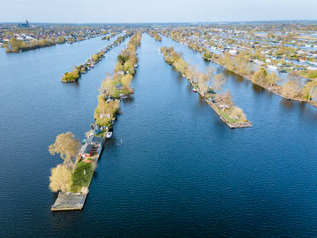 Aerial view of small islands in the Lake Vinkeveense Plassen, near Vinkeveen, Holland. It is a beautiful nature area for recreation in the Netherlands. Vinkeveen is mainly famous for the Vinkeveense Plassen Reklamní fotografie
