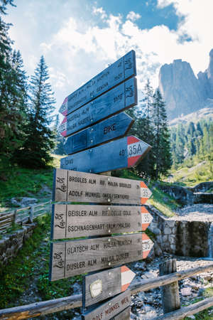 Geisler Alm, Dolomites Italy, hiking in the mountains of Val Di Funes in Italian Dolomites,Nature Park Geisler-Puez with Geisler Alm in South Tyrol. Italy Europe, road signal