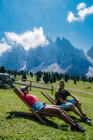 Geisler Alm, Dolomites Italy, hiking in the mountains of Val Di Funes in Italian Dolomites,Nature Park Geisler-Puez with Geisler Alm in South Tyrol. Italy Europe, couple man and woman hiking mountains