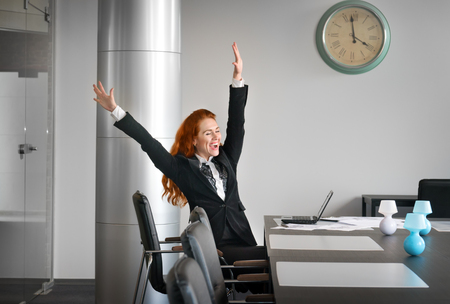 rigor: girl working in an office and is glad hands up