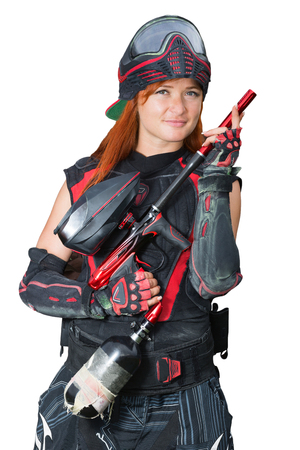 Portrait of a girl in uniform with paintball guns and on the isolated background
