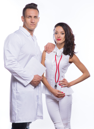garb: Guy and girl in medical garb and with documents in hands on a white background
