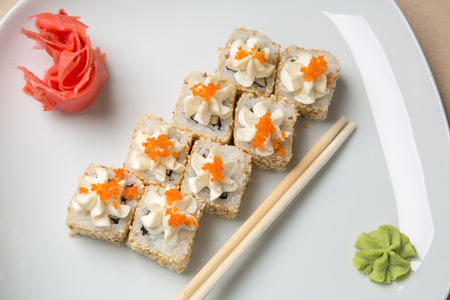 Delicious pieces of sushi, on white background