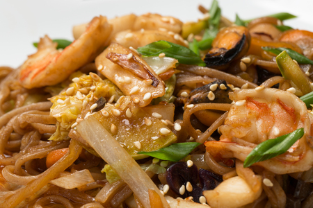 buckwheat noodles with seafood on white plate in restaurant Stock Photo