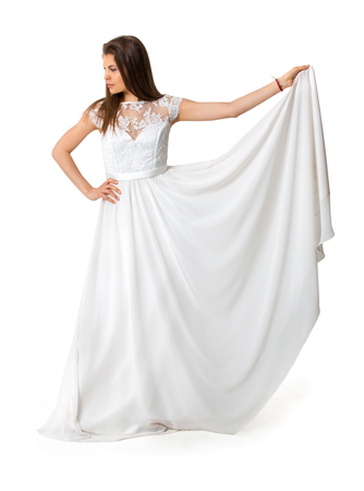 mode: girl in white long dress on isolated background Stock Photo