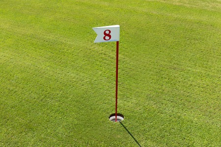 hole in the Golf course with number. Playing Golf on the green grass