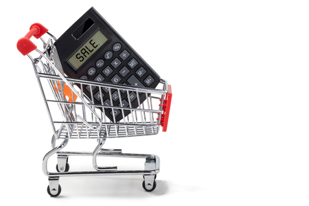 calculator with the inscription sale on the screen in the shopping cart on an isolated background Stock Photo