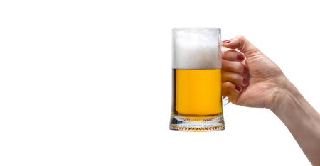 womens hand with a beer mug on an isolated background Stock Photo - 130145510
