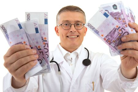 a doctor in a medical gown is holding a lot of money euros and rejoices