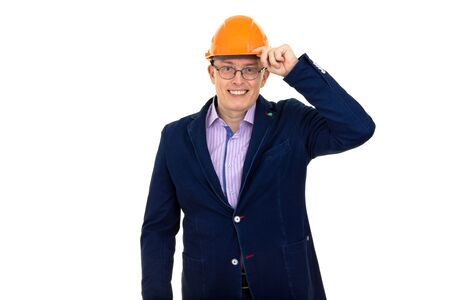 a man in a dark blue jacket and construction helmet peers into the frame