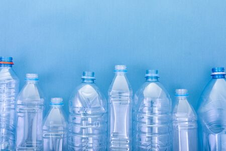 plastic bottles on a blue cardboard background. concept ecology and science Stock fotó