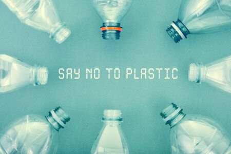 plastic bottles on a blue cardboard background. concept ecology and science. free space for text. toned in shades image