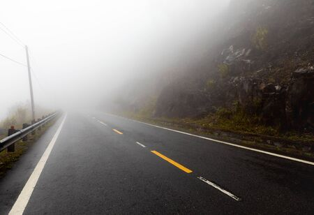 foggy road with yellow markings in the mountainous region of Vietnam