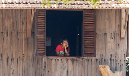 Vietnam Phu Quoc island 2 April 2019. Vietnamese girl waitress from the cafe sad and looks out the window