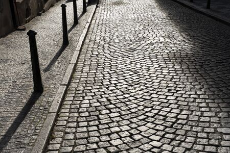 cobblestones on the street of Prague in the background light on a Sunny evening