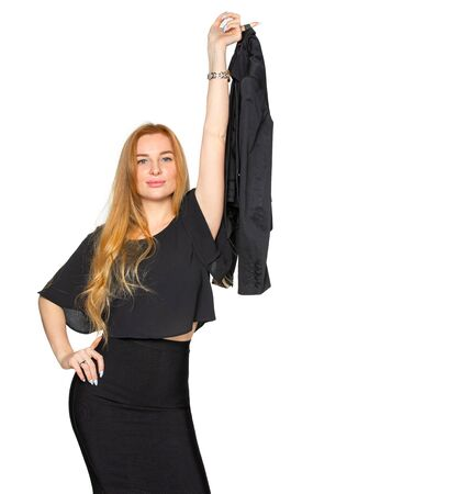a blonde woman holding a dark jacket on an isolated white Studio background. woman held the jacket up at arms length