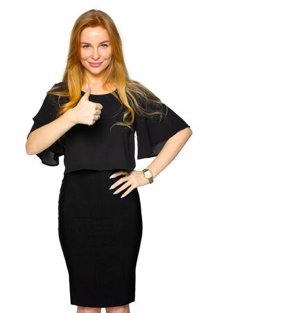 blond woman showing thumbs up gesture of success. girl in dark clothing on a white isolated background