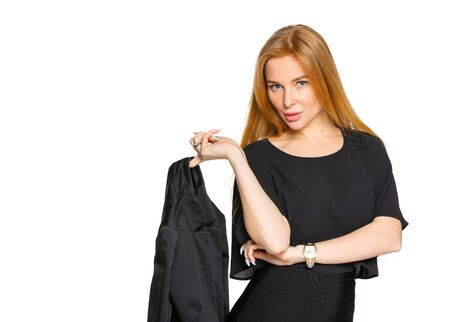 a blonde woman holding a dark jacket on an isolated white Studio background. free place for copy paste
