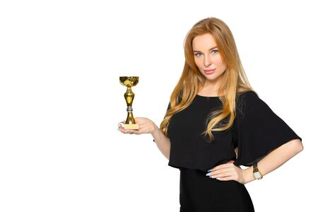 a young blonde woman with a souvenir award in her hands. winner of the contest. the concept of victory and recognition. Archivio Fotografico - 142847802