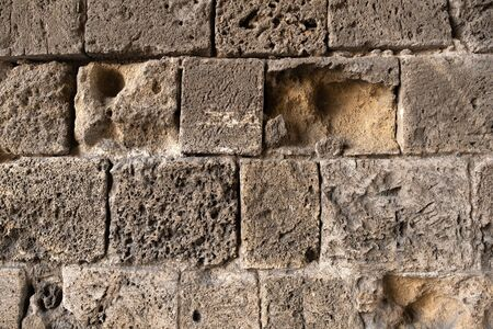 fragment of an old stone wall in the old city. wall in the old city Archivio Fotografico - 142962710