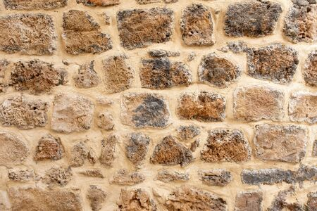 fragment of an old stone wall in the old city. wall in the old city Archivio Fotografico - 142962732