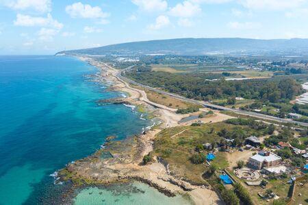The Israeli coast of the Mediterranean Sea near the city of Nahariya. Near the Banana Beach. Aerial shot in the daytime.
