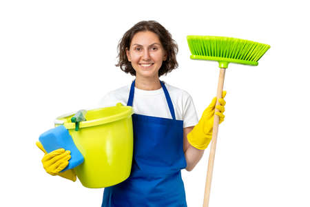 woman cleans the house. The woman is holding a mop and a bucket and gloves and a cleaning sponge. indoor cleaning concept. isolated