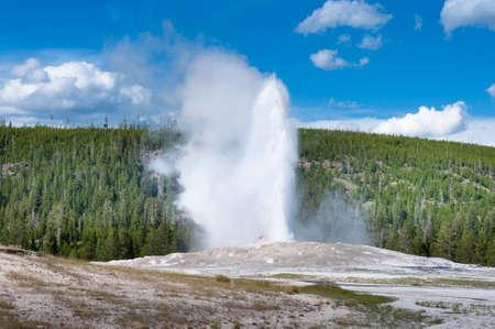 faithful: Old Faithful geyser eruption at Yellowstone National Park, USA Stock Photo