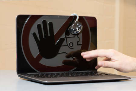 crime: Lock at Notebook. Concept of stopping tinternet crime.