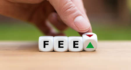 Symbol for increasing or decreasing fees. Hand turns a dice and changes the direction of an arrow. Dice form the word