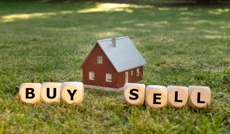 To buy or sell a house? Cubes form the words