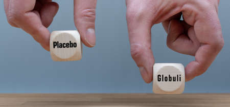Homeopathy effect more than the placebo effect? Hand selects cube with the German word