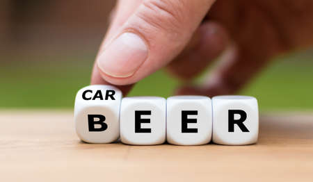 Stop drinking alcohol concept. Hand turns a dice and changes the word beer to career.
