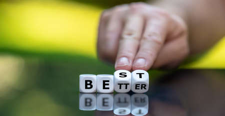 Hand turns dice and changes the word better to best.