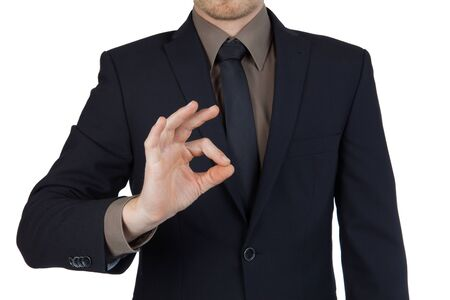 internationally: Young successful businessman showing okay symbol isolated Stock Photo