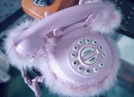 plush: Retro pink desk telephone with plush Stock Photo