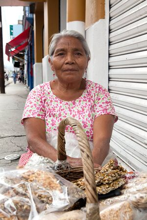 woman street: Elderly woman selling traditional Mexican sweets on the street in Oaxaca, Mexico