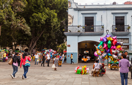town square: Some locals in the Zocalo Town Square in OaxacaMexico