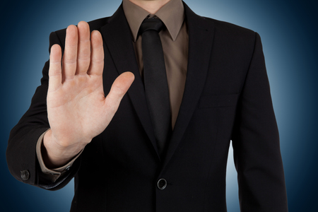 Businessman showing stop gesture or stay