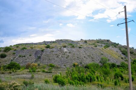 ore slag dumps after processing. Old stepped terricon in the form of a hill with terraces