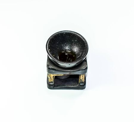 An ashtray carved from black stone. Creative of stone.