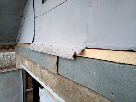 Repair of the pediment of the house. Steel pediment on the garage. Roof repair.
